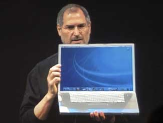 Steve Jobs holding 17 inch Powerbook